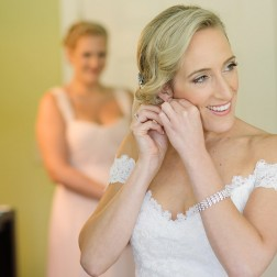 Bride getting ready photos, statement earrings for her outdoor Washington DC area wedding ceremony, day of coordination by Glow Weddings and Events